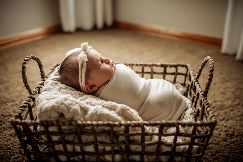 New baby swaddled in a basket