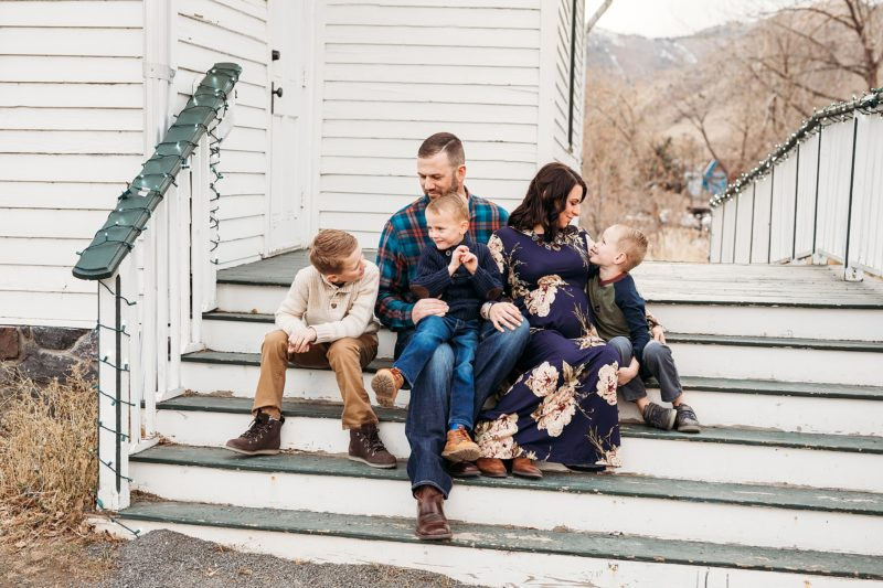 Family of five posed on steps